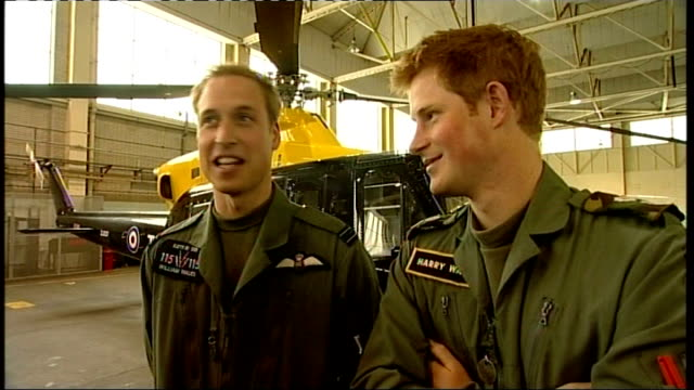 shawbury: defence helicopter flying school: ext prince william and prince harry posing for photocall in front of military helicopter int prince... - 薄毛点の映像素材/bロール