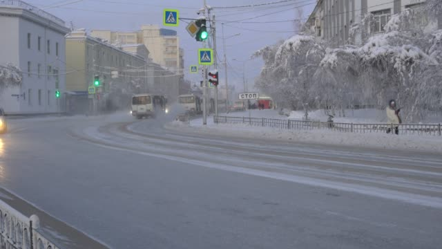 shrouded in ice and fog, the city of yakutsk in winter is the coldest in the world - pavel gospodinov stock videos & royalty-free footage