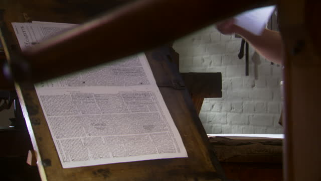 ms pan shto fo technician lays newly printed pages on top of each other in colonial era printing press / williamsburg, virginia, united states - colonial reenactment stock videos & royalty-free footage