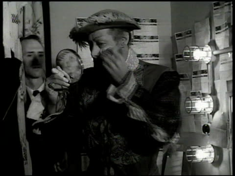 stockvideo's en b-roll-footage met shubert theatre 'call boy' knocking on dressing room doors '5 minutes' ms rex harrison touching up makeup male 'dresser' putting on his coat ms... - 1949