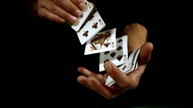 slo mo shuffling playing cards - hand of cards stock videos & royalty-free footage