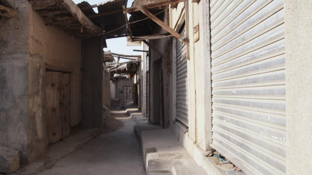 ws shuttered shops in souk, bahla, oman - shutter stock videos and b-roll footage
