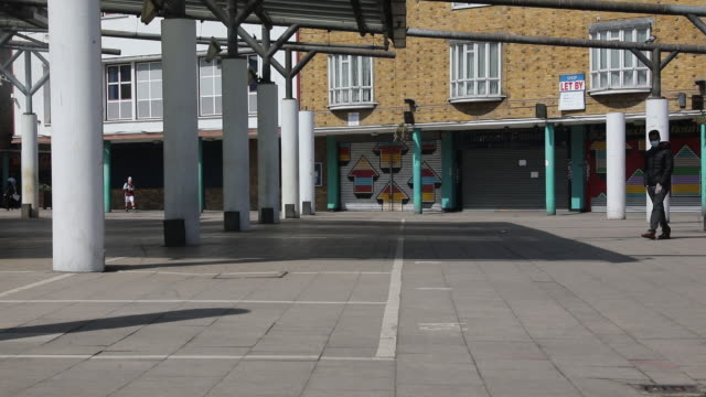 shuttered stores in the east end of london closed due to the impact of the coronavirus lockdown in london, england, uk, on wednesday, april 15, 2020. - residential district stock videos & royalty-free footage
