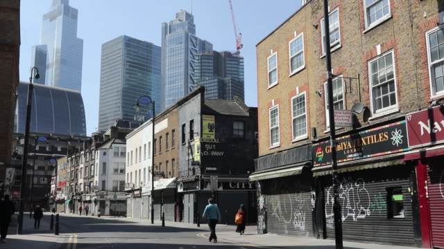 shuttered stores in the east end of london closed due to the impact of the coronavirus lockdown in london, england, uk, on wednesday, april 15, 2020. - shutter stock videos & royalty-free footage
