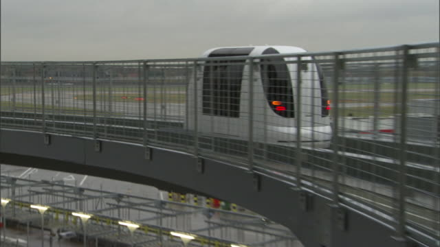 a shuttle carries passengers along a monorail system to heathrow airport. - monorail stock videos & royalty-free footage