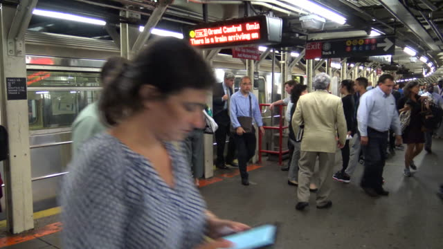 """shuttle subway """"s"""", times square, new york city - 42nd street stock videos & royalty-free footage"""