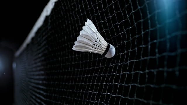 slo mo shuttlecock hitting the net - netting stock videos & royalty-free footage