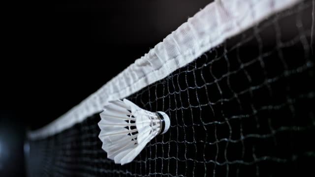 slo mo shuttlecock striking the net - net sports equipment stock videos and b-roll footage