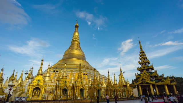 shwedagon pagoda and blue sky, day to dusk time lapse video - day to dusk stock videos & royalty-free footage