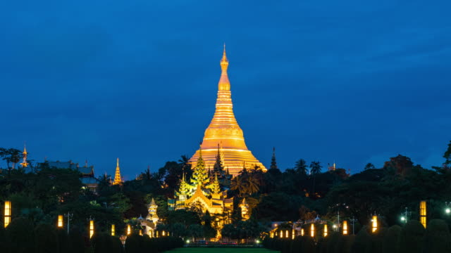 shwedagon pagoda in the morning, day to dusk time lapse video - day to dusk stock videos & royalty-free footage