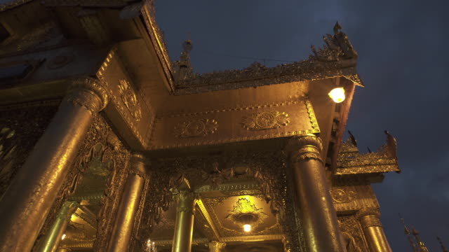 w/s long dolly track side shwedagon pagoda, yangon (myanmar), night - circa 6th century stock videos & royalty-free footage