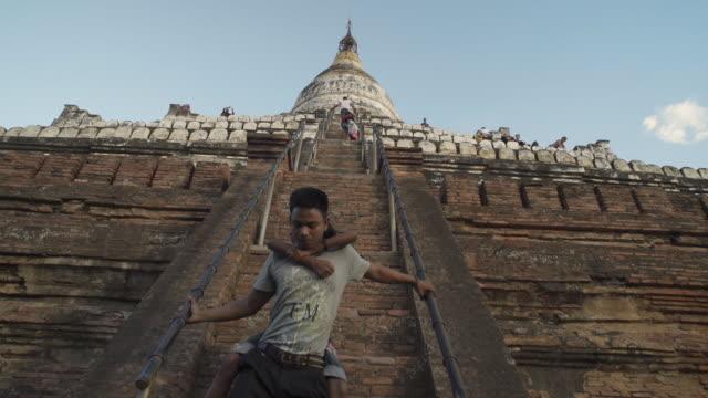 vídeos y material grabado en eventos de stock de w/s walking upstairs shwesandaw temple, bagan - myanmar