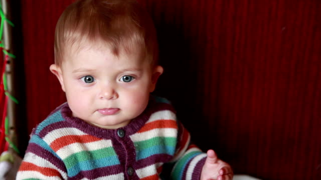 shy baby looking down - part of a series stock videos & royalty-free footage