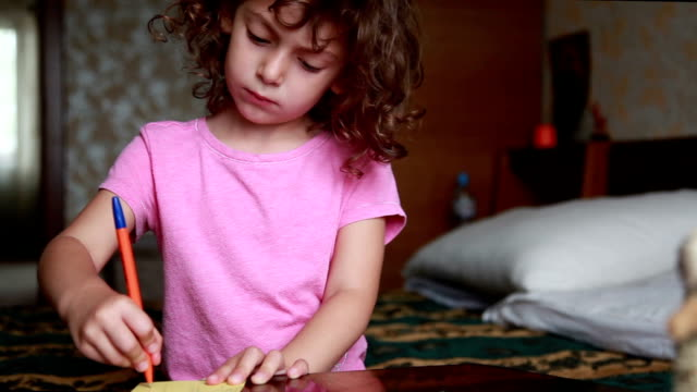 shy little girl drawing a line with a pen - uncomfortable stock videos & royalty-free footage