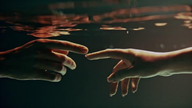 vídeos de stock e filmes b-roll de shy, sensual touch. underwater romance - lento