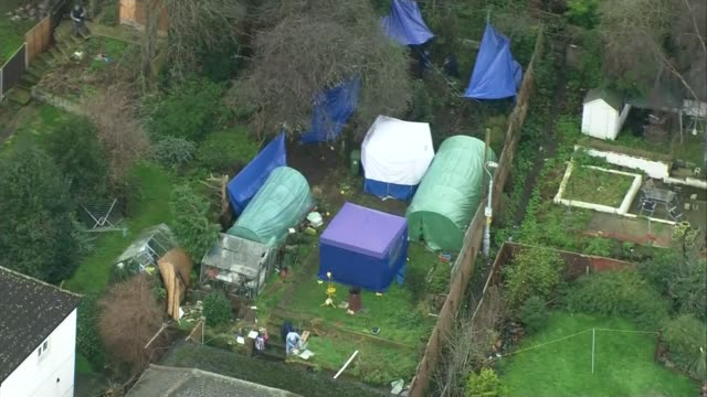 arthur simpson-kent admits to murders; t05011638 / tx air view forensic officers and forensic tents in garden of blake family home where bodies of... - eastenders stock videos & royalty-free footage