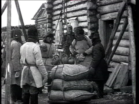 siberia or central russia trees destruction lumberjacks' everyday life in prerevolutionary russia or early 1920s weighing bags on scale grains of... - russland stock-videos und b-roll-filmmaterial