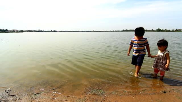 sibling at laskshore - brother stock videos & royalty-free footage
