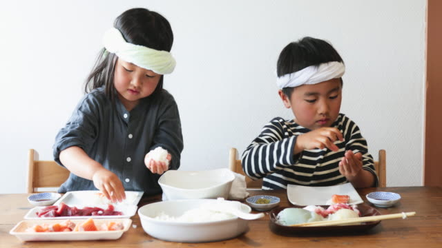 siblings cooking sushi at home - simple living stock videos & royalty-free footage