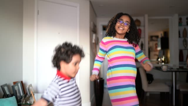 siblings dancing at home - mixed race person stock videos & royalty-free footage