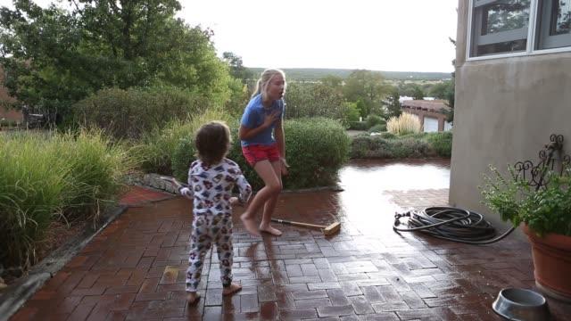 siblings dancing in the rain - front stoop stock videos & royalty-free footage
