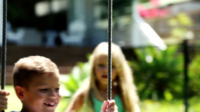 siblings have fun on the swing - swinging stock videos & royalty-free footage