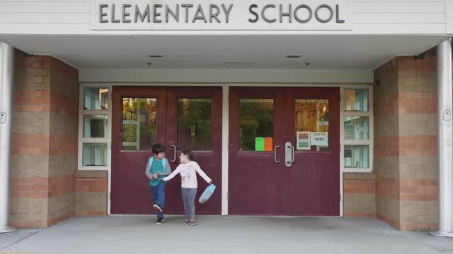 siblings leaving school - elementary school stock videos & royalty-free footage