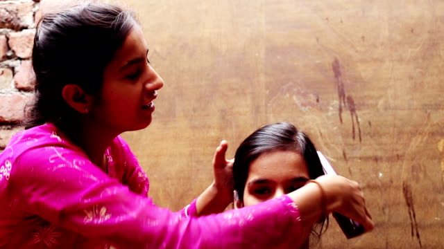 siblings making ponytail at home - courtyard stock videos & royalty-free footage