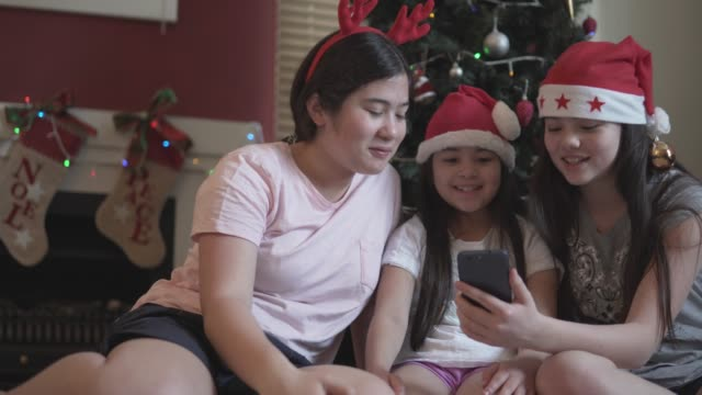 siblings on a video call during christmas - sibling stock videos & royalty-free footage