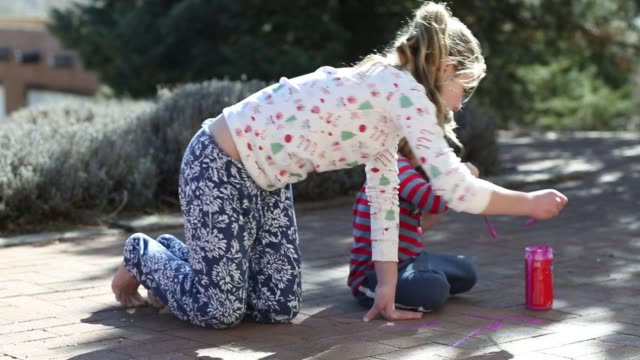 siblings painting on brick patio - tracksuit bottoms stock videos & royalty-free footage