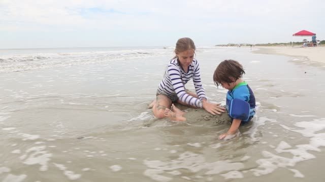 siblings playing at the beach - men's underpants stock videos and b-roll footage