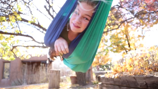 siblings playing in hammock - swinging stock videos and b-roll footage