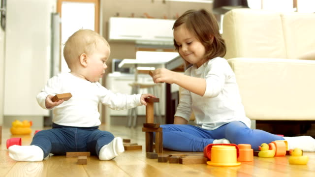 siblings playing with toys - toy block stock videos and b-roll footage
