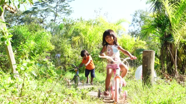 siblings riding a bicycle in a rural place - indigenous culture stock videos & royalty-free footage