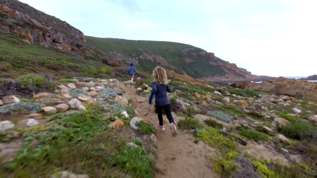 siblings running along mountain trail - footpath stock videos & royalty-free footage