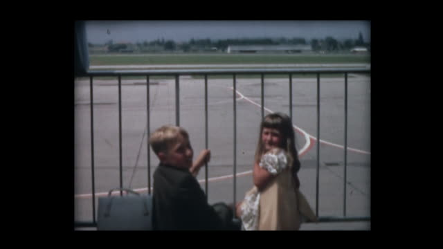 1966 siblings seeing off sister at airport - abitacolo video stock e b–roll