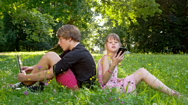 WS DS Siblings Using Digital Tablet And Smart Phone