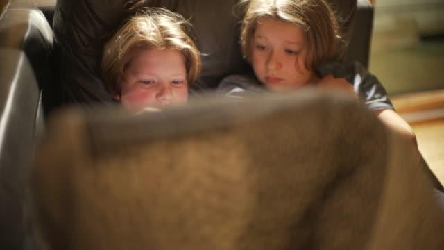 siblings watching screens. - brother stock videos & royalty-free footage