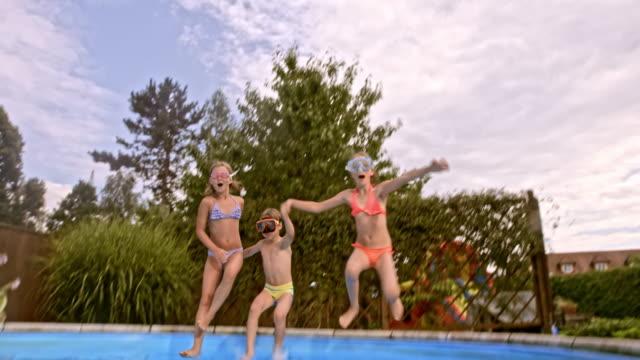 siblings with swimming masks doing thumbs up underwater in the pool - swimming goggles stock videos & royalty-free footage