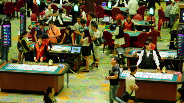 vídeos de stock, filmes e b-roll de sic bo poker black jack tables venentian casino macau china no - macau