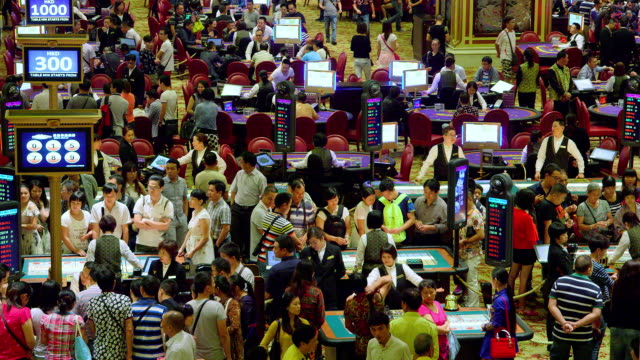 sic bo, poker & black jack tables; venentian casino, macau, china. no audio - macao stock videos & royalty-free footage