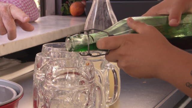 sicilian tonic is poured into tankards - filling stock videos and b-roll footage