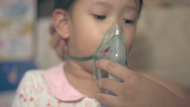 sick asian girl getting nebulizer treatment - aerosol can stock videos & royalty-free footage