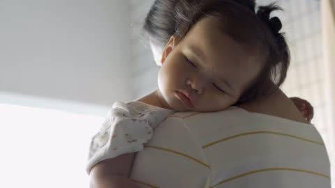 sick baby girl sleeping on her mother's shoulder - holding stock videos & royalty-free footage