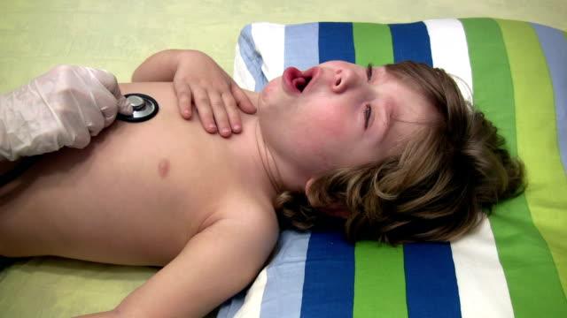 sick boy - boy medical exam stock videos and b-roll footage