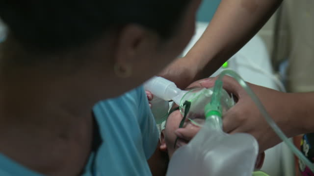 stockvideo's en b-roll-footage met a sick child being treated at a hospital in manila philippines - ledematen lichaamsdeel