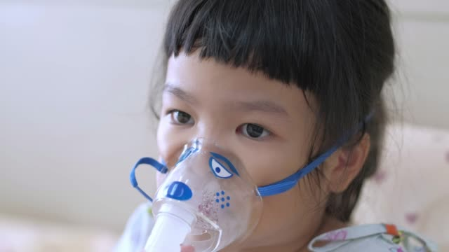 sick child breathes through nebulizer - inhaling stock videos & royalty-free footage