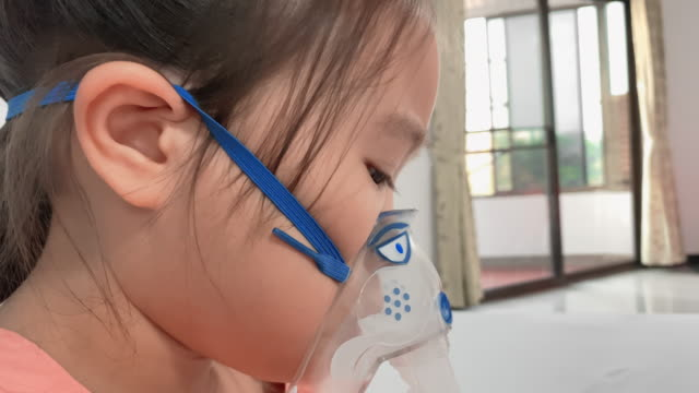 sick children girl with nebulizer mask in hospital - trachea stock videos & royalty-free footage
