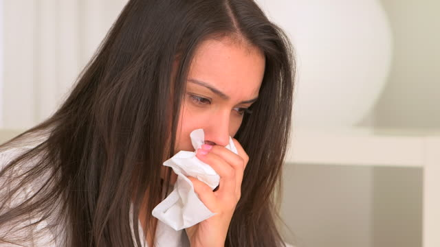 sick hispanic woman with tissue in hand - hay fever stock videos and b-roll footage