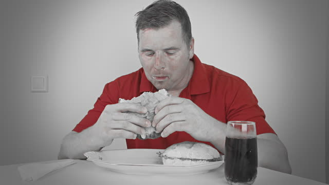 hd time lapse: sick man eating hamburgers - over eating stock videos & royalty-free footage